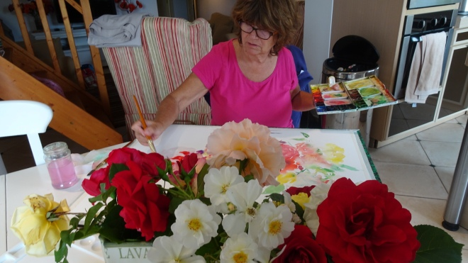 Tess painting roses
